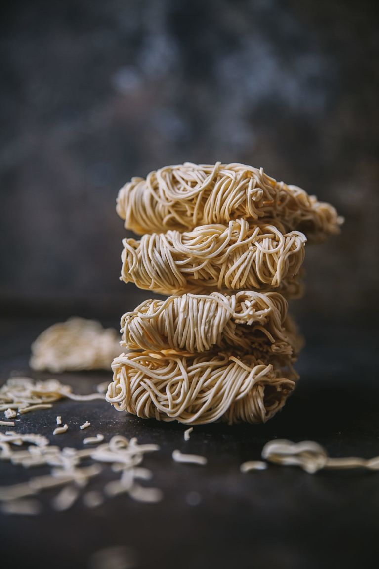 Uncooked dried noodles stacked up