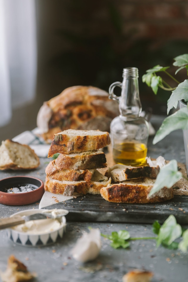 Stack of artisan bread with a bottle of olive oil on the side.